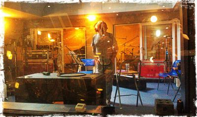 Charlie putting down vocals - click to enlarge